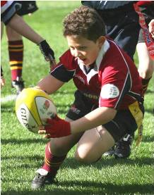 Child playing rugby