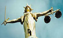 Statue of Lady Justice on top of Old Bailey